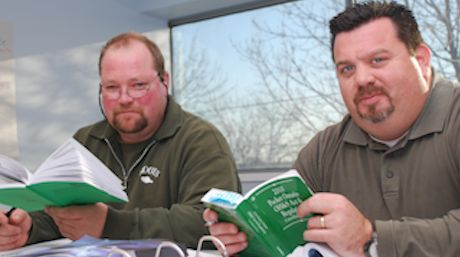 Two Guys with Green WHSC Books